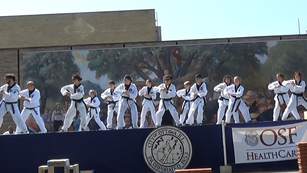 Black belts perform one of their forms during the annual Riverfest.