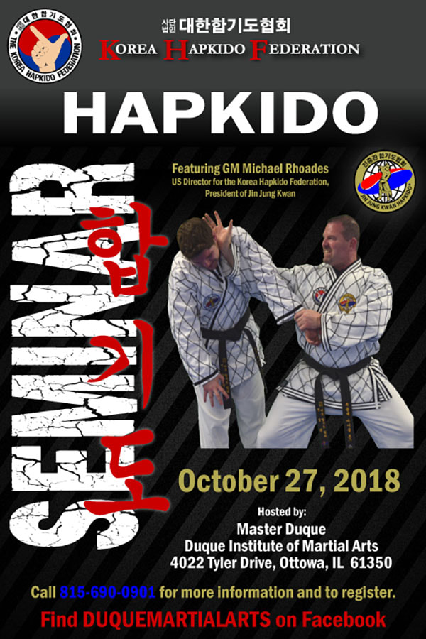 Poster for hapkido seminar features grand master performing self defense technique on black belt.